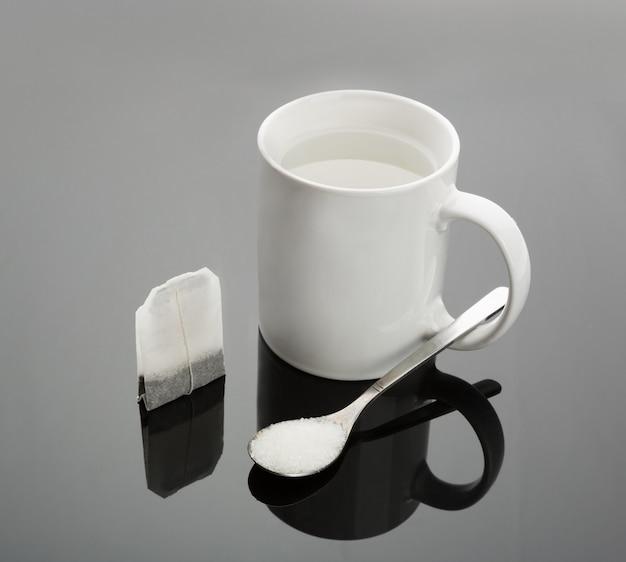 Cup, spoon and tea bag