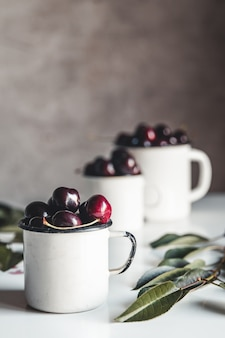 A cup of sweet cherries on a concrete background. organic eco product, farm. no gmo