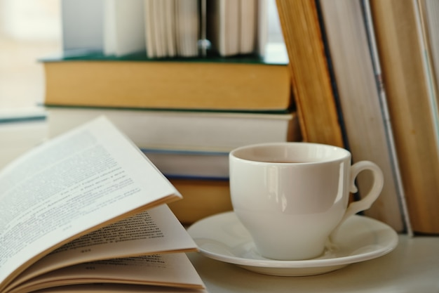Cup of tea on a background of old books