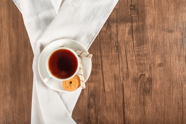 A cup of tea on a blue tablecloth