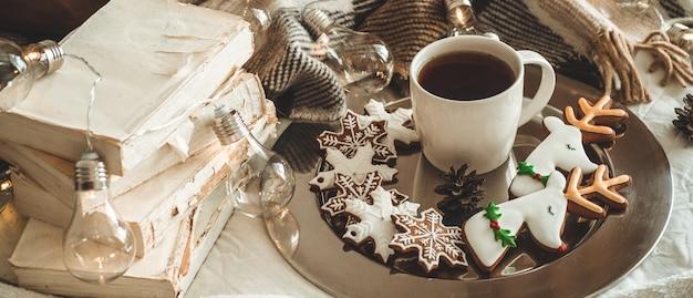 Cup tea and christmas cookies