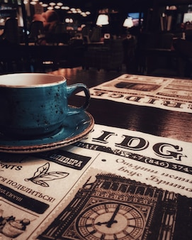 A cup of tea or coffee, a bar, a restaurant, a newspaper.