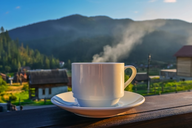 A cup of tea,coffee, standing on the porch of the hotel balcony