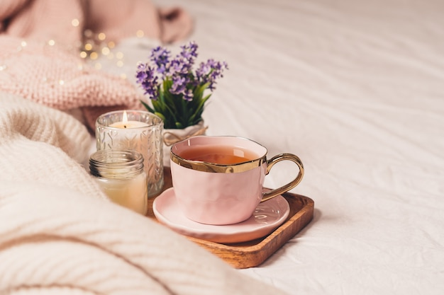 Cup of tea, cotton, cozy, book, candle. cosy autumn winter concept.