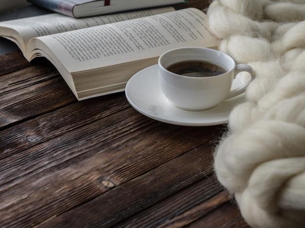 Cup of tea. cozy composition, closeup merino wool blanket