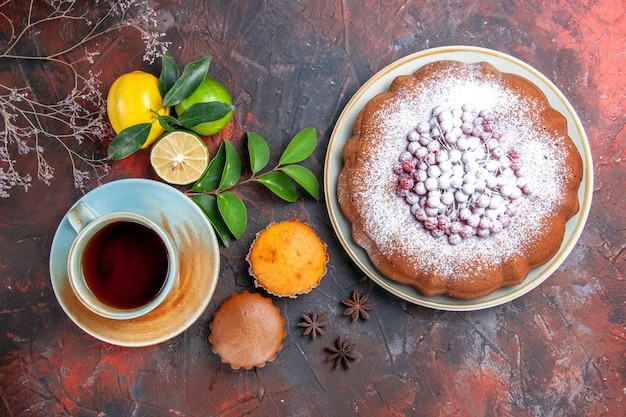 A cup of tea cupcakes a cup of tea a cake with berries lemons limes star anise