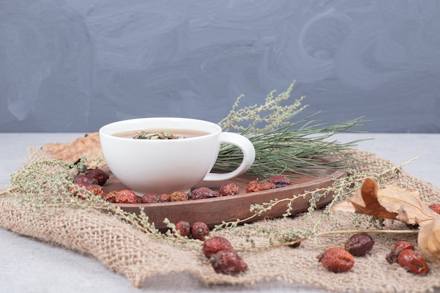 Cup of tea and dried cranberries on burlap. high quality photo
