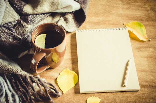 A cup of tea and empty notebook for sketch.