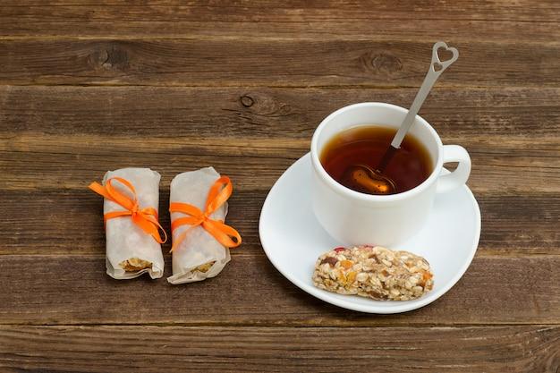 Cup of tea and few bar of muesli.