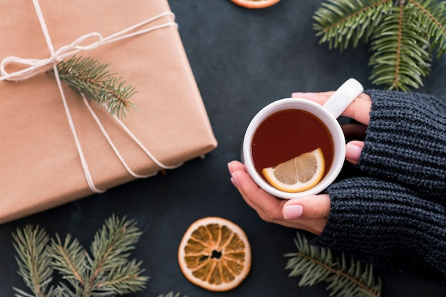 Cup of tea and gift in wrapping paper