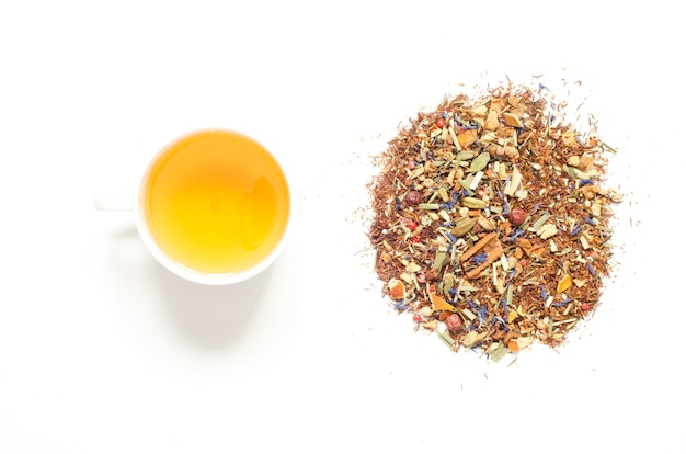 Cup of tea. herbal tea, dry herbs and flowers with pieces of fruit and berries.  top view.