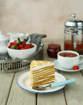 A cup of tea and a piece of cake in the cafe