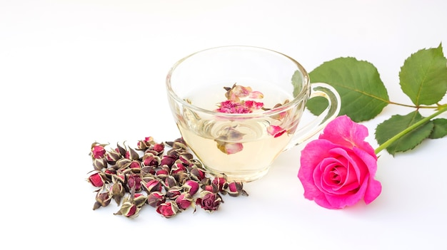 A cup of tea pink rose on a white background.