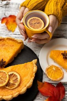 Cup of tea and sliced pumpkin pie