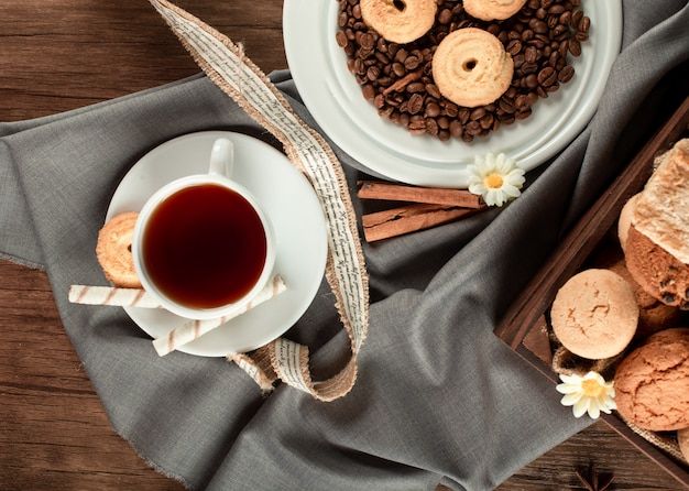 A cup of tea and sugar cookies. top view