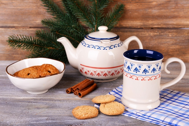 Cup of tea on table on wooden background