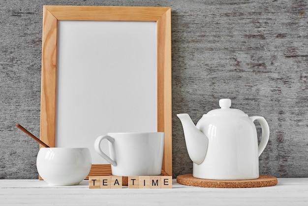 Cup of tea, teapot, sugar bowl, mockup
