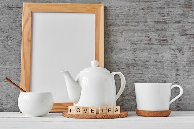 Cup of tea, teapot, sugar bowl