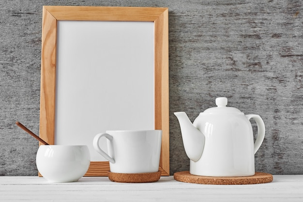 Cup of tea, teapot, sugar bowl