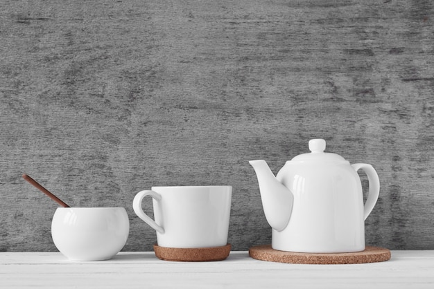 Cup of tea, teapot and sugar bowl