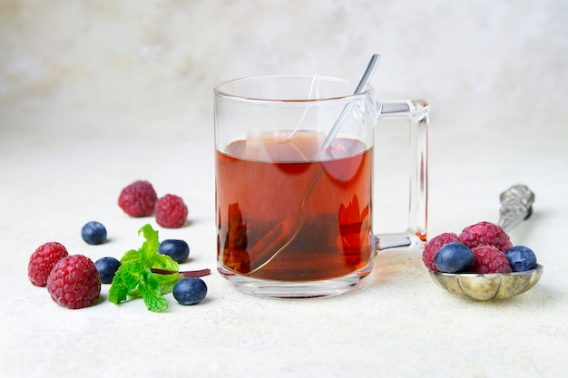 Cup of tea with berry