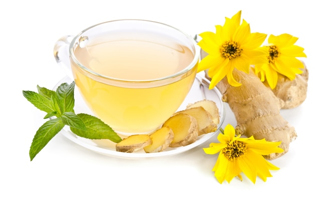 Cup of tea with ginger slices and echinacea flower near isolated on white