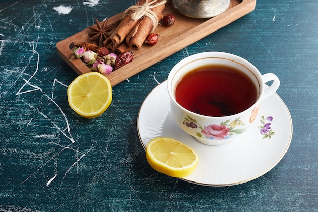 A cup of tea with herbs.