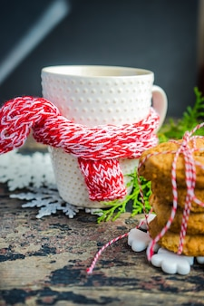 Cup of tea with lemon and christmas decoration