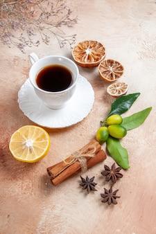 A cup of tea with lemon and cinnamon sticks
