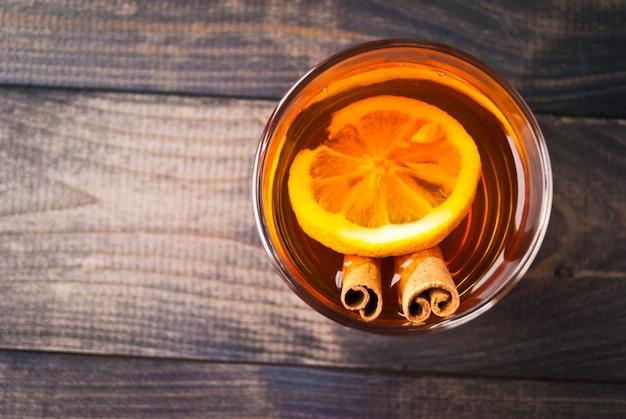 Cup of tea with lemon and cinnamon