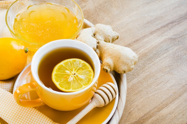 Cup of tea with lemon ginger and honey.