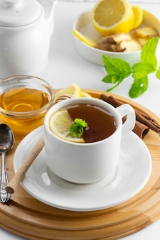 Cup tea with lemon and honey on a white . hot tea cup isolated, top view. autumn, fall or winter drink. copyspace.