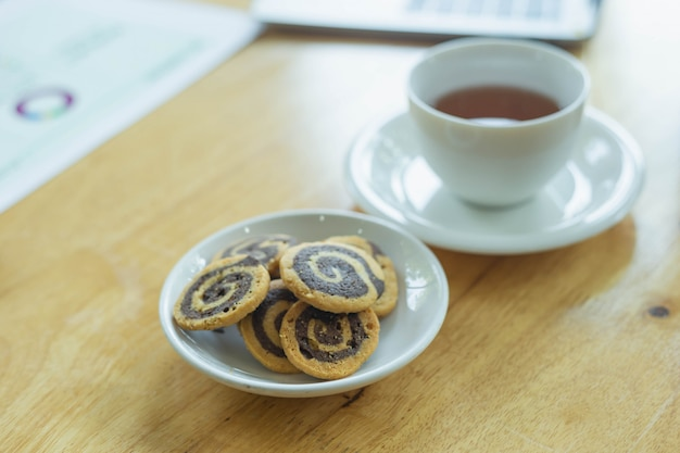 Cup of tea with oatmeal cookies on a wooden