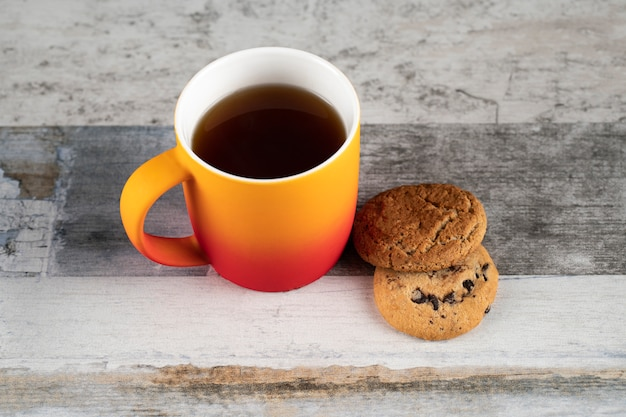 A cup of tea with oatmeal cookies