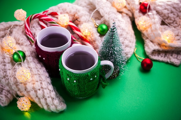 Cup of tea with a scarf christmas background