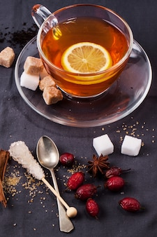 Cup of tea with sugar and spices