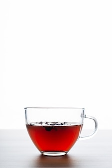 Cup of tea with a white background on a wooden table