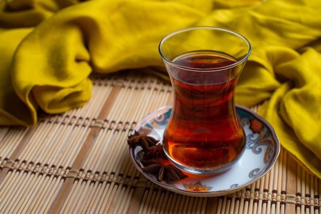 A cup of tea with yellow scarf
