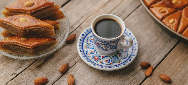 A cup of turkish coffee and baklava. selective focus.