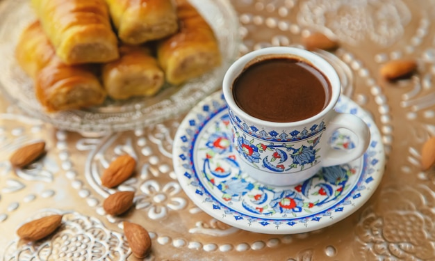 A cup of turkish coffee and baklava.
