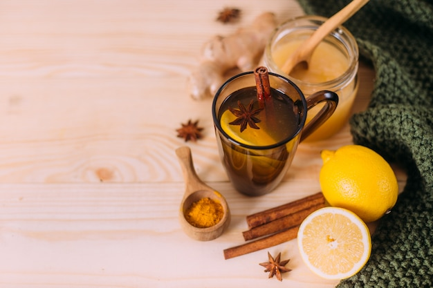 Cup warm water with lemon, honey, ginger root, cinnamon and anise.
