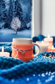 Cup with coffee and candles, autumn scene