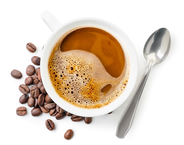 Cup with coffee, coffee beans and spoon close up on white background, isolated. top view