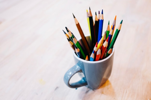 Cup with colored pencils