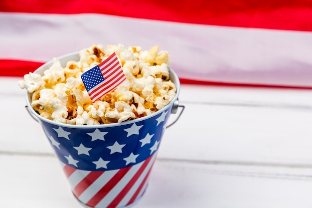 Cup with emblem of american flag and crunchy popcorn