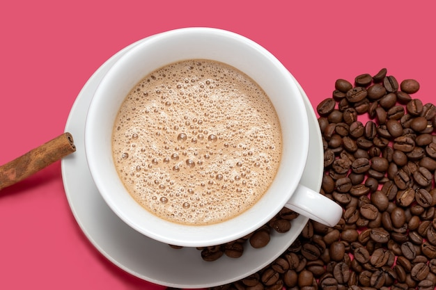 Cup with espresso latte and isolated on pink background