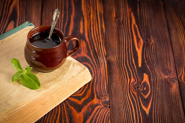 Cup with green tea on wood