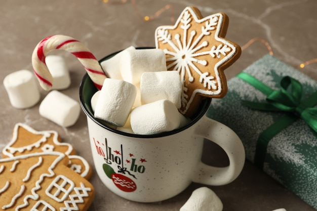 Cup with marshmallow and christmas accessories