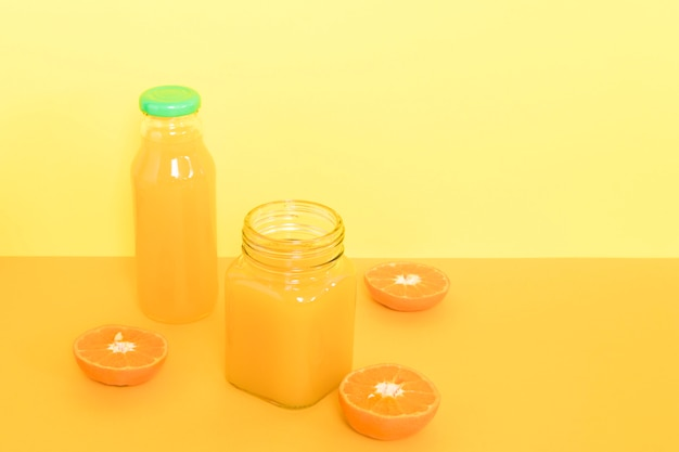 Cup with orange smoothie