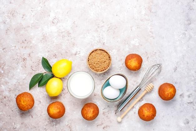 Cupcake baking background with kitchen utensils.